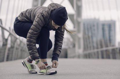 athlete-tying-running-shoes_4460x4460.jpg